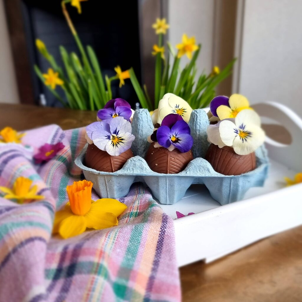 Easter egg cheesecake with edible flowers on top